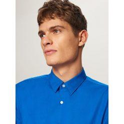 Elegancka koszula z tkaniny poplin - Niebieski. Niebieskie koszule męskie Reserved, z tkaniny. Za 79.99 zł.