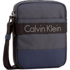 Saszetka CALVIN KLEIN - Madox Reporter K50K502853  411. Niebieskie saszetki męskie Calvin Klein, z materiału, młodzieżowe. W wyprzedaży za 329.00 zł.