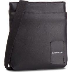 Saszetka CALVIN KLEIN JEANS - Coated Canvas Micro Flat Pack K40K40814 001. Czarne saszetki męskie Calvin Klein Jeans, z jeansu, młodzieżowe. Za 299.00 zł.