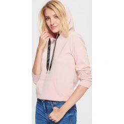 Gładka bluza kangurka - Różowy. Bluzy damskie marki KALENJI. W wyprzedaży za 39.99 zł.