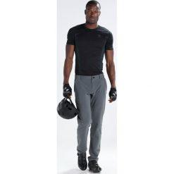 Pearl Izumi VERSA  Spodnie materiałowe shadow grey. Spodnie materiałowe męskie marki House. W wyprzedaży za 384.30 zł.