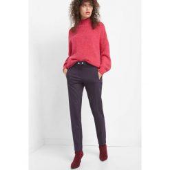 Żakardowe spodnie w kant. Niebieskie spodnie materiałowe damskie Orsay, z elastanu. Za 139.99 zł.