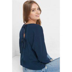 Koszulka z kokardkami. Niebieskie bluzki damskie Orsay, z dzianiny. Za 69.99 zł.