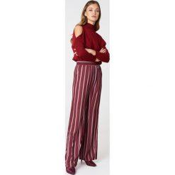 NA-KD Szerokie spodnie z wysokim stanem - Red,Multicolor. Czerwone spodnie materiałowe damskie NA-KD, z poliesteru. Za 121.95 zł.