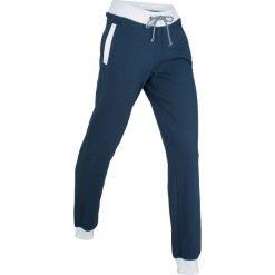 Spodnie sportowe, długie bonprix ciemnoniebieski. Niebieskie spodnie dresowe damskie bonprix. Za 74.99 zł.