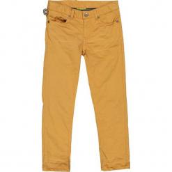 """Dżinsy """"Dancing In The City"""" w kolorze musztardowym. Jeansy dla chłopców marki Reserved. W wyprzedaży za 122.95 zł."""