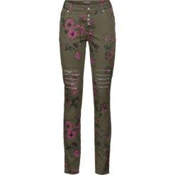 Spodnie Skinny bonprix ciemnooliwkowy z nadrukiem. Zielone spodnie materiałowe damskie bonprix, z nadrukiem. Za 149.99 zł.