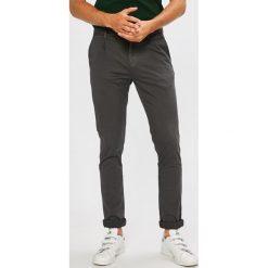 Calvin Klein Jeans - Spodnie. Szare eleganckie spodnie męskie Calvin Klein Jeans, z bawełny. Za 449.90 zł.