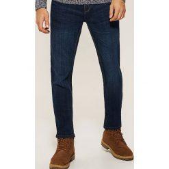 Jeansy regular fit - Granatowy. Niebieskie jeansy męskie House. Za 129.99 zł.