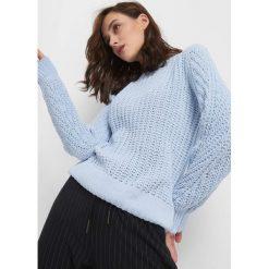 Sweter z widocznym splotem. Czerwone swetry damskie Orsay, z dzianiny. Za 99.99 zł.