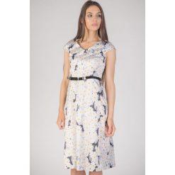 Sukienka z paskiem w stokrotki QUIOSQUE. Szare sukienki dla dziewczynek QUIOSQUE, w kolorowe wzory, z bawełny. W wyprzedaży za 79.99 zł.