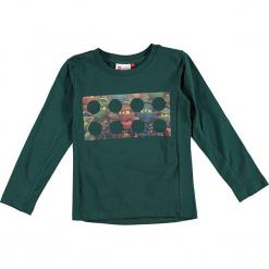 """Koszulka """"Thomas 717"""" w kolorze ciemnozielonym. Zielone t-shirty dla chłopców marki Lego Wear Fashion, z bawełny, z długim rękawem. W wyprzedaży za 59.95 zł."""