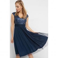 Tiulowa sukienka z cekinami. Niebieskie sukienki damskie Orsay, z dzianiny, wizytowe, dekolt w kształcie v, z krótkim rękawem. Za 199.99 zł.