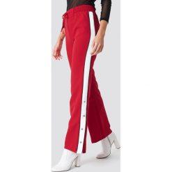 Trendyol Spodnie z zatrzaskami - Red. Czerwone spodnie materiałowe damskie Trendyol. Za 121.95 zł.