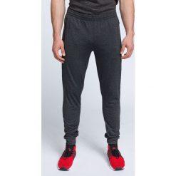 Spodnie treningowe męskie SPMTR002 - ciemny szary melanż. Spodnie sportowe męskie marki bonprix. W wyprzedaży za 149.99 zł.