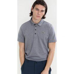 Lacoste Sport Koszulka polo marine/blanc. Koszulki sportowe męskie Lacoste Sport, z bawełny. Za 359.00 zł.