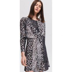 Sukienka ze zwierzęcym motywem - Kremowy. Białe sukienki damskie Reserved, z motywem zwierzęcym. Za 159.99 zł.