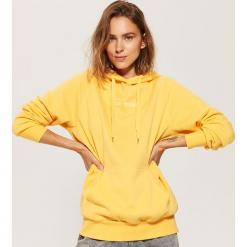 Bluza oversize z kapturem - Żółty. Bluzy damskie marki KALENJI. W wyprzedaży za 49.99 zł.