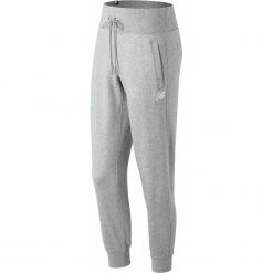 New Balance WP81548AG. Szare spodnie dresowe damskie New Balance, z dresówki. W wyprzedaży za 129.99 zł.