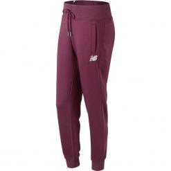 New Balance WP73535WNS. Brązowe spodnie dresowe damskie New Balance, z bawełny. W wyprzedaży za 149.99 zł.