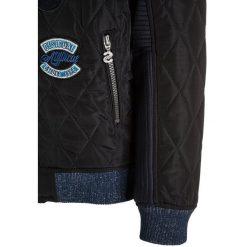 Desigual CUT Kurtka zimowa navy. Kurtki i płaszcze dla dziewczynek Desigual, na zimę, z elastanu. W wyprzedaży za 359.10 zł.