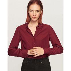Koszula o klasycznym fasonie - Bordowy. Koszule damskie marki SOLOGNAC. W wyprzedaży za 39.99 zł.