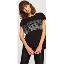 T-shirt z nadrukiem - Czarny. T-shirty damskie marki DOMYOS. W wyprzedaży za 14.99 zł.
