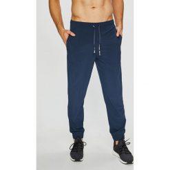 Calvin Klein Performance - Spodnie. Szare spodnie sportowe męskie Calvin Klein Performance, z elastanu. Za 269.90 zł.