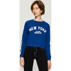 Bluza z lampasami - Niebieski. Bluzy damskie marki KALENJI. W wyprzedaży za 24.99 zł.