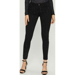 Spodnie skinny z dżetami - Czarny. Czarne spodnie materiałowe damskie Sinsay. Za 99.99 zł.
