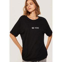 T-shirt oversize - Czarny. T-shirty damskie marki DOMYOS. Za 29.99 zł.