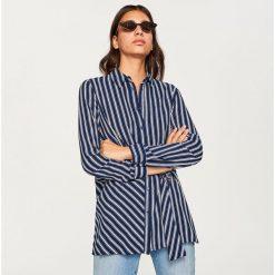 Koszula w paski - Granatowy. Koszule damskie marki SOLOGNAC. W wyprzedaży za 39.99 zł.