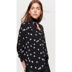 Klasyczna koszula z nadrukiem - Czarny. Koszule damskie marki SOLOGNAC. W wyprzedaży za 39.99 zł.