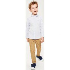 Bawełniana koszula w kratkę - Niebieski. Koszule dla chłopców marki Giacomo Conti. W wyprzedaży za 79.99 zł.