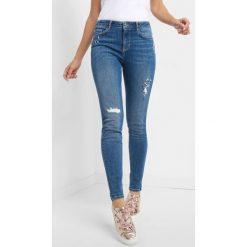 Jeansy skinny z kryształkami. Niebieskie jeansy damskie Orsay. Za 139.99 zł.