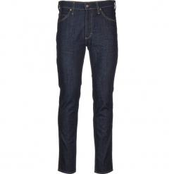 """Dżinsy """"Tramper"""" - Slim fit - w kolorze granatowym. Niebieskie jeansy męskie Mustang. W wyprzedaży za 173.95 zł."""