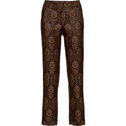 Spodnie z materiału w optyce aksamitu bonprix czarno-złoty wzorzysty. Spodnie materiałowe damskie marki DOMYOS. Za 49.99 zł.