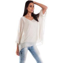 Koszulka w kolorze beżowym. T-shirty damskie 100% Soie, klasyczne, z okrągłym kołnierzem, z długim rękawem. W wyprzedaży za 130.95 zł.