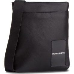 Saszetka CALVIN KLEIN JEANS - Coated Canvas Flat Pack K40K400812 001. Czarne saszetki męskie Calvin Klein Jeans, z jeansu, młodzieżowe. Za 349.00 zł.