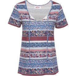 T-shirt z wiązanym troczkiem i nadrukiem, krótki rękaw bonprix niebieski dżins z nadrukiem. T-shirty damskie marki DOMYOS. Za 44.99 zł.