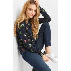 ee2a20e361e424 Koszulka w kwiaty. Bluzki damskie marki Orsay. W wyprzedaży za 35.00 zł.