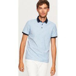 Koszulka polo w drobny wzór - Niebieski. Niebieskie koszulki polo męskie Reserved. Za 59.99 zł.