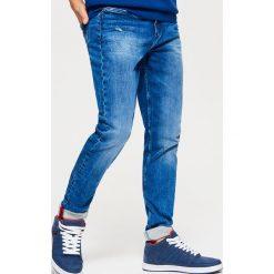 Jeansy SLIM - Granatowy. Niebieskie jeansy męskie Cropp. Za 139.99 zł.