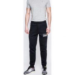 Puma - Spodnie. Szare spodnie sportowe męskie Puma, z bawełny. W wyprzedaży za 139.90 zł.