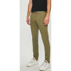 Tommy Hilfiger - Spodnie. Brązowe eleganckie spodnie męskie Tommy Hilfiger, z bawełny. Za 449.90 zł.