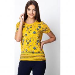 Żółta bluzka z kwiatowym motywem QUIOSQUE. Żółte bluzki damskie QUIOSQUE, w kwiaty, z bawełny, wakacyjne, z długim rękawem. Za 79.99 zł.