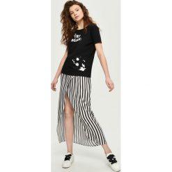 T-shirt z wycięciem na plecach - Czarny. T-shirty damskie marki DOMYOS. W wyprzedaży za 14.99 zł.