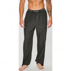 Calvin Klein Underwear - Spodnie piżamowe. Czarne piżamy męskie Calvin Klein Underwear, z bawełny. W wyprzedaży za 159.90 zł.