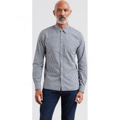 """Koszula """"Sunset"""" w kolorze niebieskim. Niebieskie koszule męskie Levi's, w kratkę, z bawełny, z klasycznym kołnierzykiem. W wyprzedaży za 130.95 zł."""