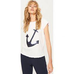 T-shirt z błyszczącą aplikacją - Biały. T-shirty damskie marki DOMYOS. W wyprzedaży za 19.99 zł.